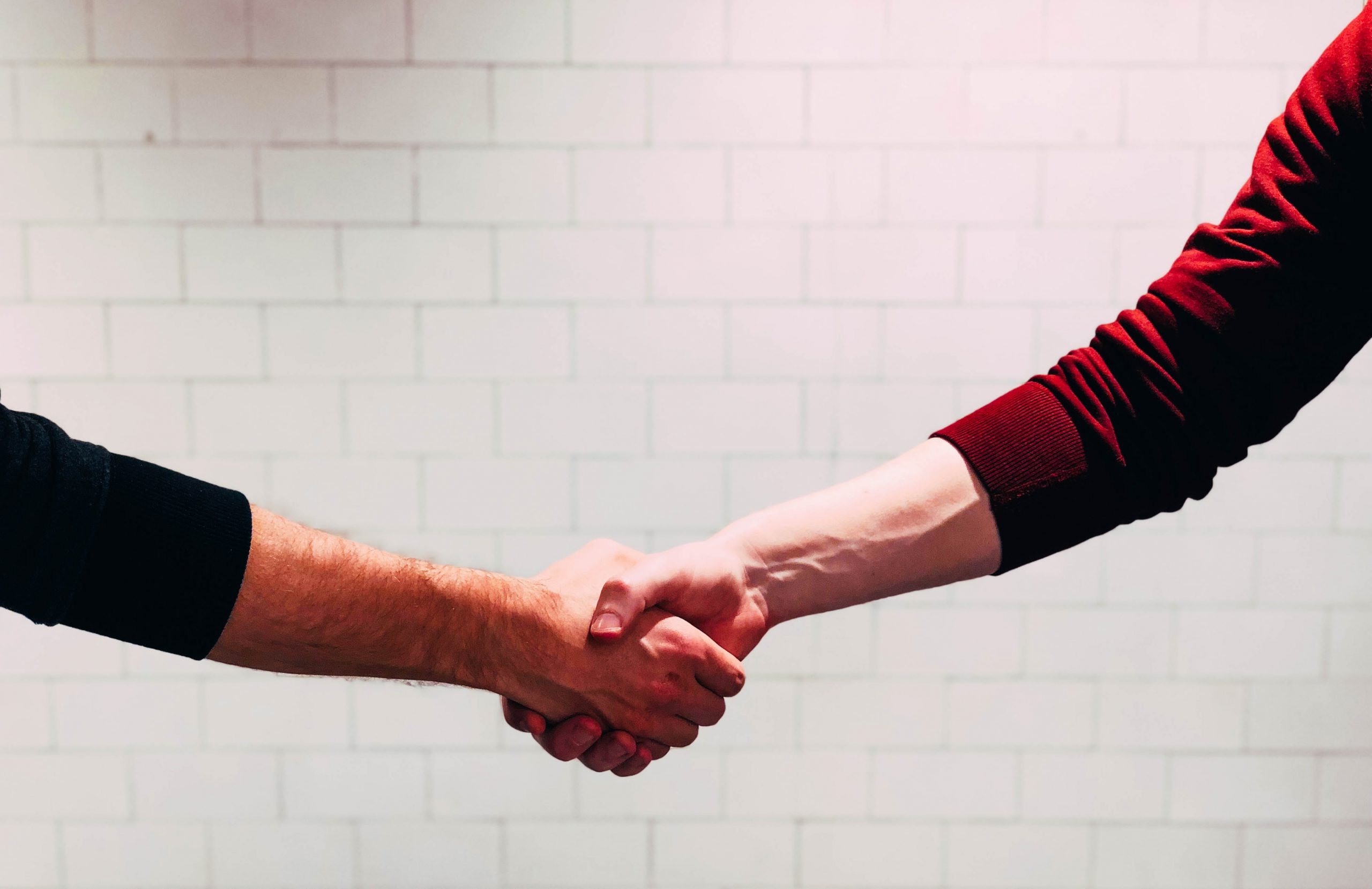 An attorney and their client shake hands