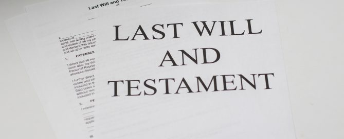 Estate planning documentation is pictured on a desk in an attorney's office