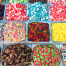 """pots of different candies of all shapes and sizes and bright colors serve as a metaphor for the different 'flavors' of lawyers you'll find while practicing law. Some will be sweet, some will be sour, but it takes """"all kinds"""""""